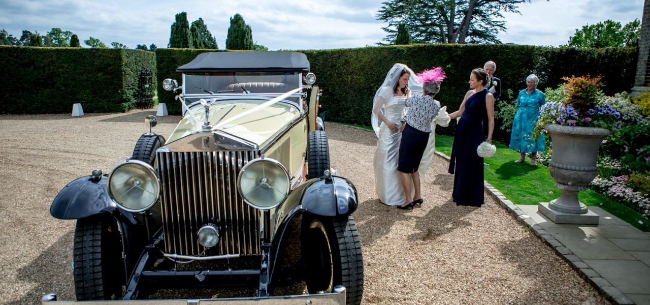 Classic Wedding car arrives at Hedsor House